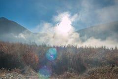 Misty dreamy mountain landscape. Deep Autumn fog Royalty Free Stock Photo