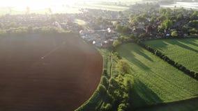 Misty fields in morning birds eye view stock video