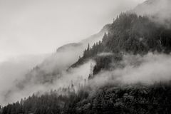 Fog covering the mountain forests with low cloud in Juneau alaska for fog landscape Royalty Free Stock Photography