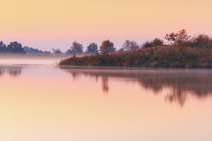 Misty Foggy Autumn Morning on a Pond Stock Photos