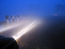 Misty foggy highways in india. Visibilty on foggy indian highways in winter Royalty Free Stock Photography