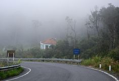Misty and foggy mountain road royalty free stock image