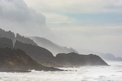 Misty and Foggy Oregon Coast with cliffs and forests Stock Photo
