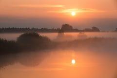 Misty foggy sunrise Stock Photos