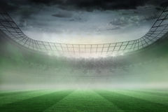 Misty football stadium under spotlights Royalty Free Stock Photo