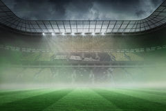 Misty football stadium under spotlights Stock Photo