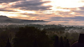Misty forest as the sun rise, as viewed from Borobudur, a 9th century Buddhist Temple in Magelang Royalty Free Stock Photo