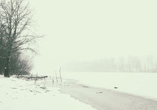 Misty and frosty winter. Snow covered and frozen Tisza river in Hungary Stock Image