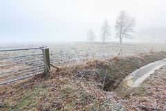 Misty frozen landscape of farmland in winter time Royalty Free Stock Images
