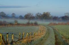 Misty German jordbruksmark Arkivbild