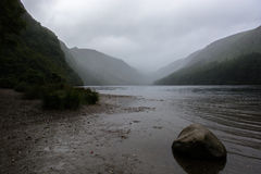 Misty Glendalough Lake in Ireland Stock Photos
