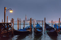 Misty gondola pier in Venice Stock Images
