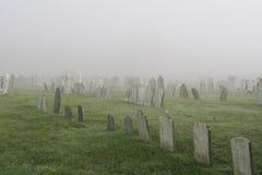 Misty Graveyard. Spooky old cemetery on a foggy morning stock photos