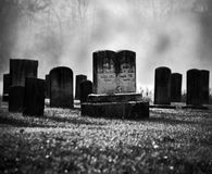Misty graveyard. Very old misty and creepy graveyard in black and white Royalty Free Stock Photo