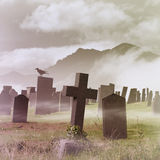 Misty Graveyard. A Misty Graveyard, Cemetery with Tombstones and Crow Stock Image