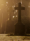Misty Graveyard at Halloween. Tombstones with crosses covered in  the morning frost and mist Stock Photo