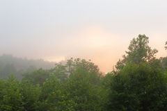 Misty hilly area with fog Stock Image