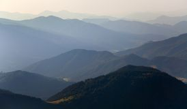 Misty horizons blue tones. View from Nizke Tatry or Low Tatras mountains - Karpathian mountains - Europe stock image