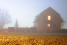 Misty House Silhouette Stock Photo