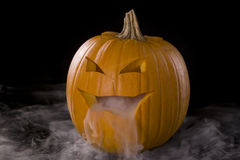 Misty Jack-o-Lantern 1. Horizontal image of a Jack-o-Lantern with mist pouring from it's mouth Stock Images