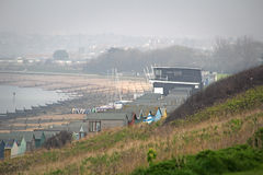 Misty kent coast beach. Photo of a misty kent coast beach showing sailing club and masts at tankerton slopes whitstable photo taken 27th march 2017 Stock Photography