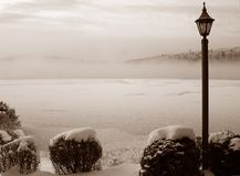 Misty lake. Mist on a frosty  lake in North Laurentians on Winter Quebec, Canada - sepia tone Royalty Free Stock Photo