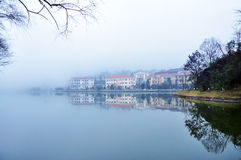 Misty lake. Evening mist along the lake at Sapa Vietnam Royalty Free Stock Photo