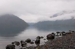 Misty lake in morning haze. Royalty Free Stock Image