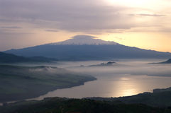 Misty on lake and mount Etna. Mist dawn on the water of the lake in background mount Etna royalty free stock photography