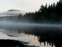 Misty Lakeside. Calming, early morning mist rising as another wonderful day begins on canoe adventure - Mistinikin Lake, Northern Ontario Stock Image