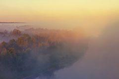 Misty landsacpe near Drohiczyn Poland. Dark foggy and mysterious view of the Bug River in Poland near Drohiczyn. Popular among Poles, the area is a place for Stock Image
