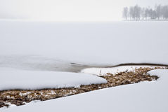 Misty landscape. A lake one misty, snowy winter-day in Sweden, Scandinavian Stock Photo