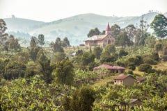 Uganda - misty landscape with church Royalty Free Stock Photo