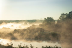 Misty landscape at river during sunrise Royalty Free Stock Photo