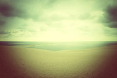 Misty landscape with sand dunes and sea Royalty Free Stock Images