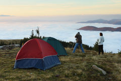 Misty morning. Mountain landscape with tent camp on the morning time Royalty Free Stock Images