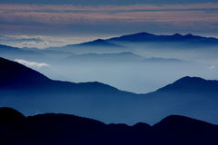 Misty morning. Over the mountains royalty free stock photography