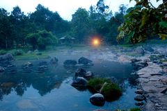 Misty morning. Sunrise at a hot spring on a cloudy morning Stock Photos