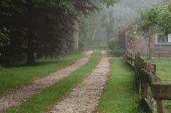 Misty morning. Farm hidden in morning mist Royalty Free Stock Photography