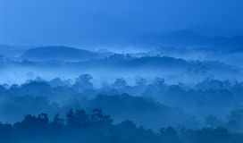 Misty morning. Of hilly area with ray of light Stock Photo
