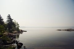 Misty Morning. Misty lakeshore with small island Stock Images