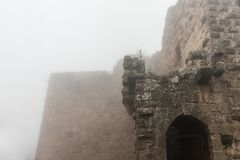 Misty morning in Ajloun Castle, also known as Qalat ar-Rabad, is a 12th-century Muslim castle situated in northwestern Jordan, nea. Irbid, Jordan, December 08 stock photos