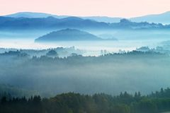 Misty morning. Autumn fog and clouds above freeze  mountain valley, hilly landscape Royalty Free Stock Photo