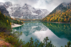 Misty morning on Braies Lake with Seekofel mount on background. Stock Photography