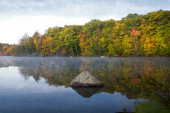 Misty Morning on Burr Pond. Fall foliage reflecting off of the misty waters of Burr Pond State Park in Torrington Connecticut in Autumn Royalty Free Stock Photos