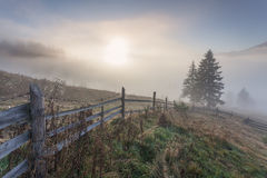 Misty morning. In the Carpathian village Dzembronia royalty free stock photo