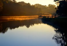 Misty Morning Dock. Sun just came up, mist rising off a salt marsh canal near the beach--Florida Royalty Free Stock Image