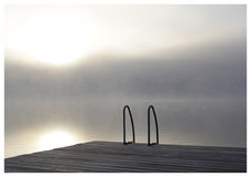 Misty morning 1. Early morning mist by the dock. You`re invited for a morning swim Stock Image