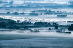 Misty morning. Misty field early morning taken from an elevated position Stock Photos