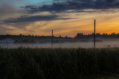 Misty morning the field. Misty Morning in Latvia, Balvi Stock Photo